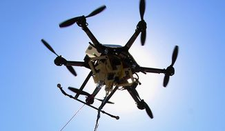 This Friday, Sept. 6, 2013, file photo shows a drone at a testing site in Lincoln, Neb. An experimental study in Sweden suggests drones equipped with heart defibrillators could help with response times for out-of-hospital cardiac arrest. (AP Photo/Nati Harnik, File)