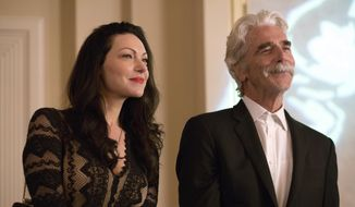 """This image released by The Orchard shows Laura Prepon, left, and Sam Elliott in a scene from, """"The Hero."""" (Beth Dubber/The Orchard via AP)"""