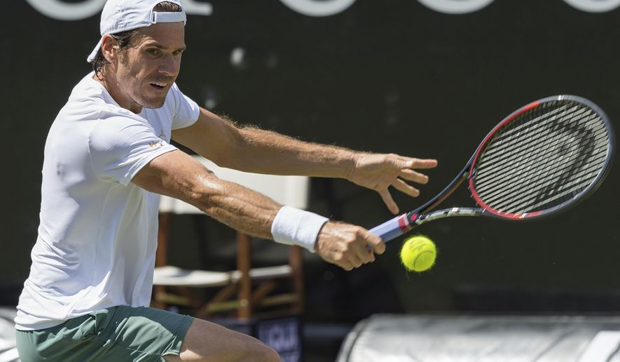 Germany's Tommy Haas returns the ball to Pierre-Hugues Herbert of France during their first round match of the Mercedes Cup tennis tournament in Stuttgart, Germany, Tuesday, June 13, 2017. (Daniel Maurer/dpa via AP)