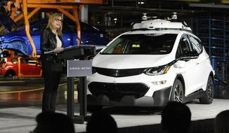 General Motors Chairman and CEO Mary Barra updates the media on the company's autonomous vehicle development program, Tuesday, June 13, 2017, at GM's Orion Assembly in Lake Orion, Mich. Barra stands next to a self-driving Chevrolet Bolt EV, one of 130 the company has built at the factory in suburban Detroit, making it among the first automakers to mass produce self-driving vehicles. (Jose Juarez/Detroit News via AP)