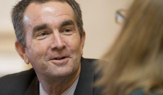 FILE - In this Thursday Jan. 26, 2016 photo, Virginia Lt. Gov., and Democratic candidate for Governor, Ralph Northam, left, talks with Senate Chief Deputy Clerk, Tara Perkinson, right, prior to the start of the Senate session at the Capitol in Richmond, Va. Virginians are set to head to the polls Tuesday, June 13, 2017, to pick a Republican and Democratic candidate in the closely watched race for governor. The highest profile contest is on the Democratic side, where Northam is in a close race with former congressman Tom Perriello. (AP Photo/Steve Helber, File)