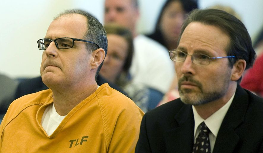 FILE - This May 2, 2014 file photo shows Scott Dekraai, left, sitting with his public defender Scott Sanders in Orange County Superior Court in Santa Ana, Calif., waiting for a ruling over over allegations of prosecutorial misconduct and misuse of jailhouse informants. A grand jury will release findings Tuesday, June 13, 2017, from an investigation into the use of jailhouse informants in Orange County amid a long-running scandal over the use of the snitches. (Kevin Sullivan/The Orange County Register via AP, File)