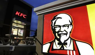 FILE - This April 18, 2011, file photo shows a KFC restaurant in Mountain View, Calif. KFC announced on June 13, 2017, that it plans to send a chicken sandwich to the edge of the atmosphere with the help of a high-altitude balloon. (AP Photo/Paul Sakuma, File)