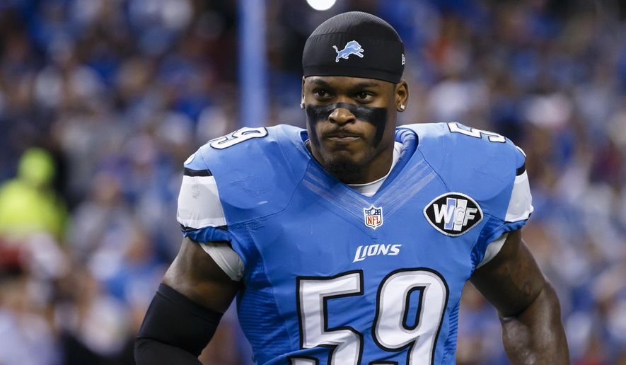 "FILE - In this Nov. 27, 2014, file photo, Detroit Lions middle linebacker Tahir Whitehead (59) watches during player introductions before an NFL football game against the Chicago Bears at Ford Field in Detroit. A man had to be escorted from the Lions' minicamp Tuesday, June 13, 2017, after approaching a field and shouting as players and coaches were practicing. The man went past an unlocked gate and approached the field, at one point yelling ""Yo, 59!"" Whitehead wears No. 59 for Detroit. (AP Photo/Rick Osentoski, File)"