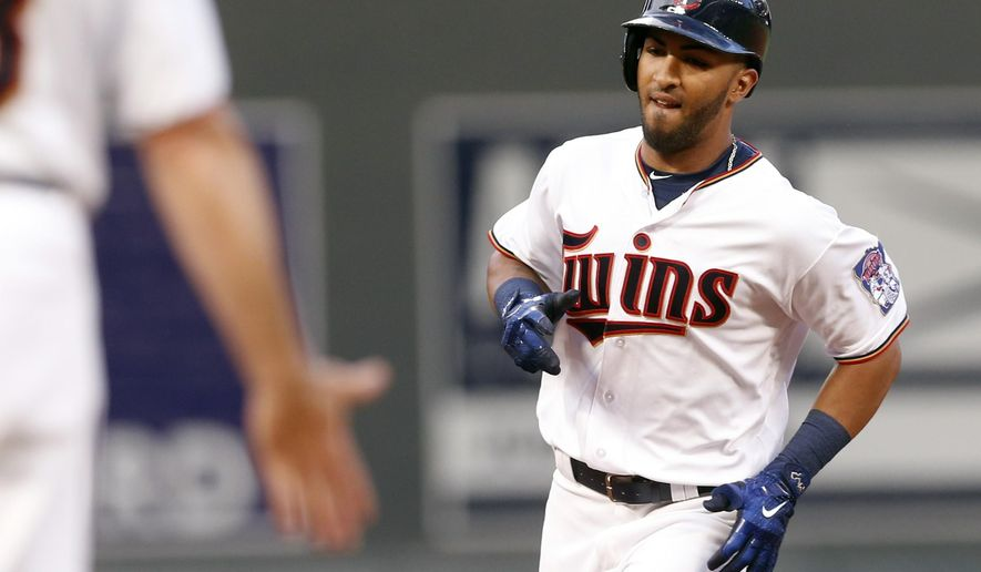Minnesota Twins' Eddie Rosario rounds third base on his two-run home run off Seattle Mariners pitcher Casey Lawrence in the third inning of a baseball game Tuesday, June 13, 2017, in Minneapolis. Rosario also hit a two-run home run off starter Christian Bergman in the second inning. (AP Photo/Jim Mone)