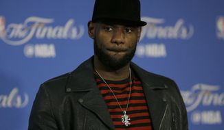 Cleveland Cavaliers forward LeBron James speaks at a news conference after Game 5 of basketball's NBA Finals between the Golden State Warriors and the Cavaliers in Oakland, Calif., Monday, June 12, 2017. The Warriors won 129-120 to win the NBA championship. (AP Photo/Ben Margot)