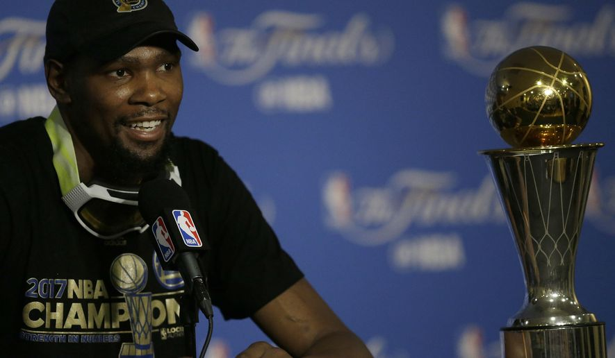 Golden State Warriors forward Kevin Durant speaks at a news conference after Game 5 of basketball's NBA Finals between the Warriors and the Cleveland Cavaliers in Oakland, Calif., Monday, June 12, 2017. The Warriors won 129-120 to win the NBA championship. (AP Photo/Ben Margot)