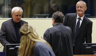 Jovica Stanisic, left. and Franko Simatovic, right,  appear  in court for their retrial at the United Nations Mechanism for International Criminal Tribunals in The Hague  The Netherlands on Tuesday, June 13, 2017. Franko Simatovic and  Jovica Stanisic the two former allies of  late Serbian President Slobodan Milosevic have gone on trial for the second time on charges of setting up and arming notorious Serb paramilitary gangs that committed atrocities in Bosnia and Croatia during the 1990s Balkan wars. (Michael Kooren/Pool via AP)