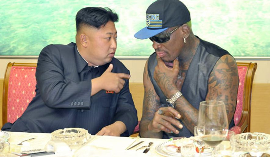 North Korean leader Kim Jong Un, left, talks with former NBA player Dennis Rodman during a dinner in North Korea in an undated photo. (Rodong Sinmun/Korea News Service via AP) ** FILE **