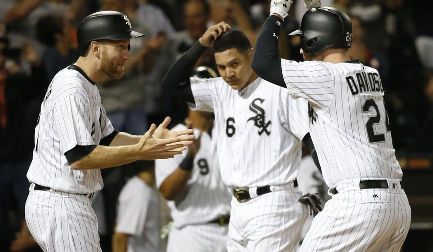 Chicago White Sox's Matt Davidson (24) celebrates his grand slam off Baltimore Orioles starting pitcher Alec Asher with Todd Frazier, left, and Avisail Garcia during the sixth inning of a baseball game Tuesday, June 13, 2017, in Chicago. (AP Photo/Charles Rex Arbogast)
