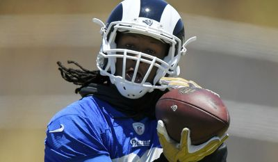 Los Angeles Rams running back Todd Gurley makes a catch during NFL football practice, Tuesday, June 13, 2017, in Thousand Oaks, Calif. (AP Photo/Mark J. Terrill)