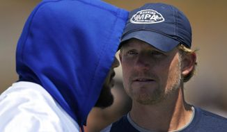 Los Angeles Rams defensive tackle Aaron Donald, left, talks with Rams general manager Les Snead during NFL football practice, Tuesday, June 13, 2017, in Thousand Oaks, Calif. (AP Photo/Mark J. Terrill)