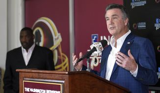 Washington Redskins president Bruce Allen, right, speaks during an NFL football press conference where it was announced that Doug Williams, left, was named Senior Vice President of Player Personnel, Tuesday, June 13, 2017, in Ashburn, Va. (AP Photo/Nick Wass)