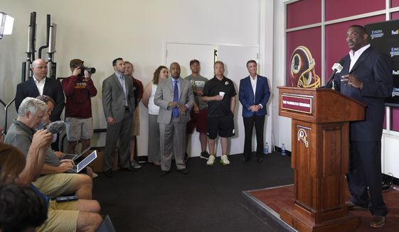 Newly announced Washington Redskins Senior Vice President of Player Personnel, Doug Williams, right, speaks during an NFL football news conference, Tuesday, June 13, 2017, in Ashburn, Va. (AP Photo/Nick Wass)