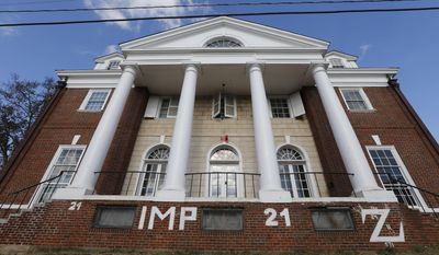 FILE - This Nov. 24, 2014, file photo, shows the Phi Kappa Psi house at the University of Virginia in Charlottesville, Va. Rolling Stone agreed to pay $1.65 million to settle a defamation lawsuit filed by the University of Virginia fraternity over a debunked story about a rape on campus, the fraternity said Tuesday, June 13, 2017. (AP Photo/Steve Helber, File)