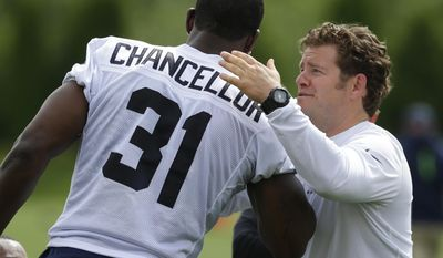 Seattle Seahawks strong safety Kam Chancellor is greeted by general manager John Schneider, right. following NFL football practice, Tuesday, June 13, 2017, in Renton, Wash. (AP Photo/Ted S. Warren)