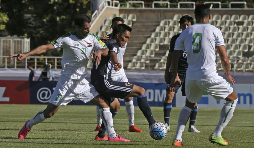 Japan's Yuya Kubo, center, and Iraq's Saad Abdulameer Al-Dobjahawe, left, vie for the ball as Ahmed Yaseen Gheni plays at right, in their Asia Group B, 2018 World Cup qualifying soccer match at the Pas Stadium in Tehran, Iran, Tueday, June 13, 2017. (AP Photo/Vahid Salemi)
