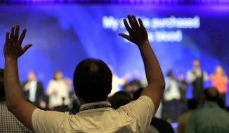 People worship during the Southern Baptist Convention annual meeting, Tuesday, June 13, 2017, in Phoenix. (AP Photo/Matt York)