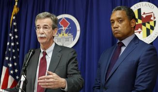 "Maryland Attorney General Brian Frosh, left, accompanied by District of Columbia Attorney General Karl Racine, speaks during a news conference in Washington, Monday, June 12, 2017, to announce what they call a ""major lawsuit"" against President Donald Trump. The lawsuit cites Trump's leases, properties and other business ""entanglements"" around the world as the reason for the suit, saying those posed a conflict of interest under a clause of the Constitution.  (AP Photo/Alex Brandon)"