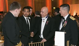 In this March 15, 2014, file photo provided by Alfredo Flores, from left, Vice Admiral Michael Rogers; Paul Monteiro, vice chairman and co-Founder of Nowruz Commission; Bijan R. Kian and Lt. Gen. Michael Flynn talk during the Fifth Annual Nowruz Commission Gala at the Andrew W. Mellon Auditorium in Washington. (Alfredo Flores via AP) ** FILE **