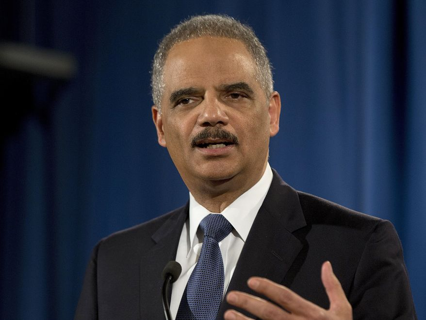 Then-Attorney General Eric Holder speaks at the Justice Department in Washington, in this March 4, 2015, photo. (AP Photo/Carolyn Kaster)