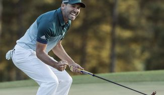 FILE - In  this April 9, 2017, file photo, Sergio Garcia, of Spain, reacts after making his birdie putt on the 18th green to win the Masters golf tournament in a playoff in Augusta, Ga. Garcia is loving his time at the U.S. Open, having finally captured the major that eluded him. He knows what's done in the past guarantees nothing. Nobody has learned that lesson in a more public fashion than Garcia. (AP Photo/Chris Carlson, File)