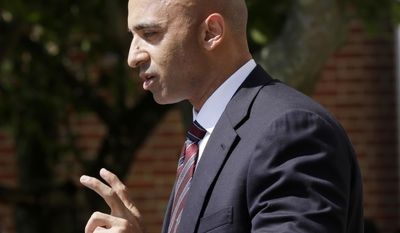 FILE - In this July 15, 2013, file photo, Yousef al-Otaiba, United Arab Emirates Ambassador to the United States speaks in Highlands, N.J. The United Arab Emirates' ambassador in Washington says the U.S. should reconsider keeping a major air base in Qatar given concerns about Qatari support for extremism.(AP Photo/Mel Evans, File)