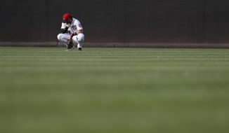 Washington Nationals right fielder Bryce Harper (34) waits in the outfield during a pitching change in the the seventh inning of a baseball game against the Atlanta Braves at Nationals Park, Wednesday, June 14, 2017, in Washington. The Braves won 13-2. (AP Photo/Carolyn Kaster)