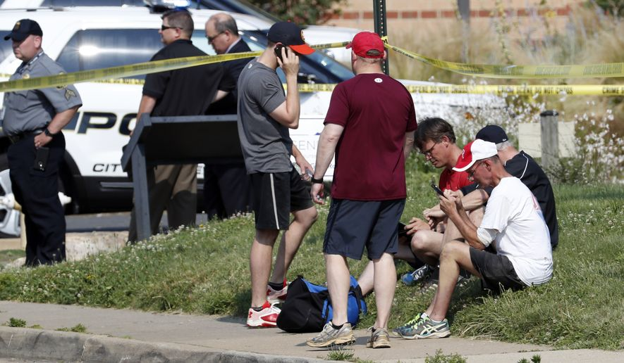 People gather near the scene of a shooting near a baseball field in Alexandria, Va., Wednesday, June 14, 2017, where House Majority Whip Steve Scalise of La. was shot during a congressional baseball practice. (AP Photo/Alex Brandon)