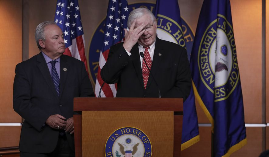 Republican team manager Rep. Joe Barton, R-Texas, right, accompanied by Democrat team manager Rep. Mike Doyle, D-Pa., speaks during a news conference on Capitol Hill in Washington, Wednesday, June 14, 2017, to discuss the shooting incident at a Congressional baseball practice in Alexandria, Va., where House Majority Whip Steve Scalise of La., and others, were shot. (AP Photo/J. Scott Applewhite)