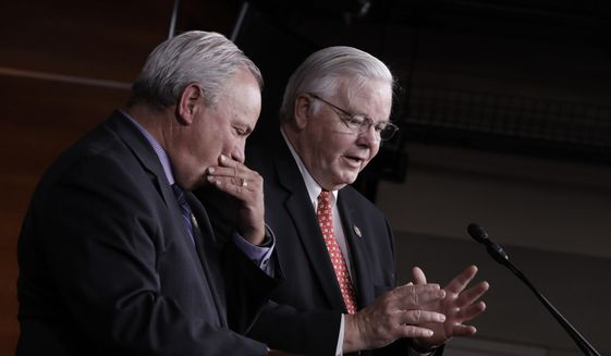 Rep. Mike Doyle, D-Pa., left and Rep. Joe Barton, R-Texas, managers of the congressional baseball teams, reflect on the shooting at a practice where a gunman wounded House Majority Whip Steve Scalise, R-La., and two Capitol police officers in Alexandria, Va., during a news conference at the Capitol in Washington, Wednesday, June 14, 2017. (AP Photo/J. Scott Applewhite)