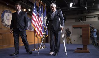 Rep. Roger Williams, R-Texas, who injured his ankle during a shooting at a congressional baseball game practice, leaves a news conference on crutches, assisted by his aide J. Spencer Freebairn, left, at the Capitol in Washington, Wednesday, June 14, 2017. (AP Photo/J. Scott Applewhite)