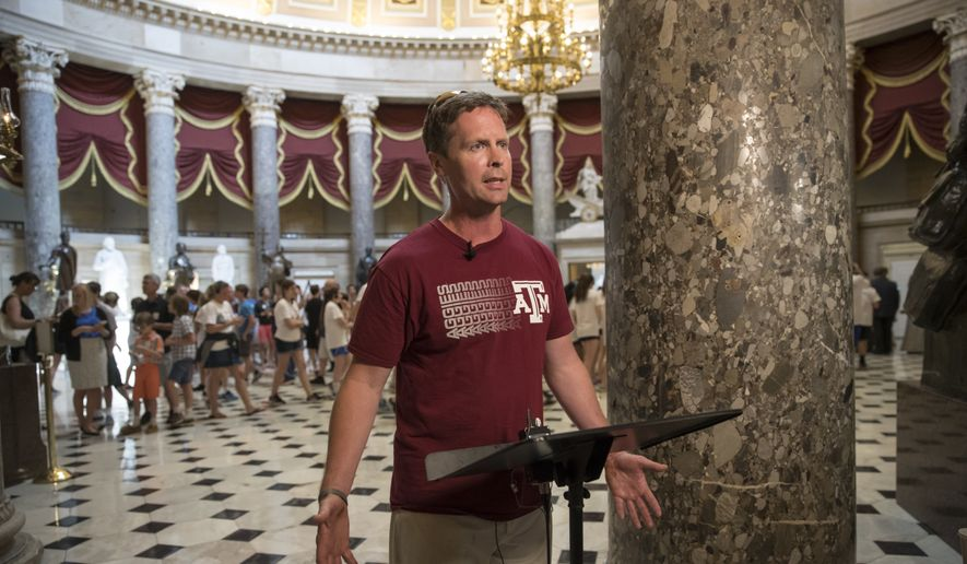 Rep. Rodney Davis, R-Ill., still wearing his baseball unifirm, describes for reporters on Capitol Hill in Washington, Wednesday, June 14, 2017, the scene during a shooting at a congressional baseball game in Alexandria, Va. where House Majority Whip Steve Scalise of La., and others, were shot.  (AP Photo/J. Scott Applewhite)