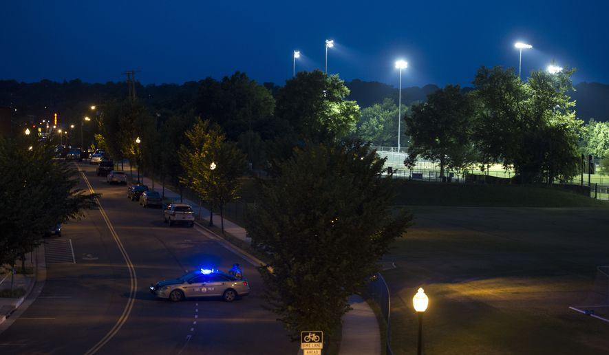 The baseball field at Eugene Simpson Stadium Park, is lighted as FBI agents process the scene in Alexandria, Va., Wednesday, June 14, 2017, after a rifle-wielding attacker opened fire on Republican lawmakers at a congressional baseball practice, wounding House GOP Whip Steve Scalise of Louisiana and several others as congressmen and aides dove for cover. (AP Photo/Cliff Owen)