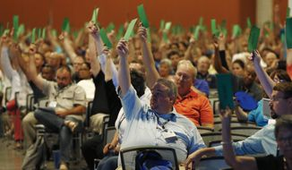 "Members attending the Southern Baptist Convention vote to formally condemn the political movement known as the ""alt-right,"" in a national meeting, Wednesday, June 14, 2017, in Phoenix. Southern Baptists on Wednesday formally condemned the political movement known as the ""alt-right,"" in the meeting that was thrown into turmoil after leaders initially refused to take up the issue. (AP Photo/Ross D. Franklin)"