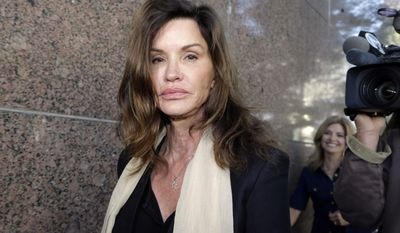 FILE - In this March 29, 2016 file photo, model Janice Dickinson leaves Los Angeles Superior Court after a judge ruled her defamation lawsuit against Bill Cosby will move forward. As Cosby awaits a verdict in his sexual assault case in Pennsylvania, the comedian's civil lawyers are fighting lawsuits against him by 10 women around the country. Dickinson claims Cosby drugged and raped her in Lake Tahoe, Calif., in 1982. (AP Photo/Nick Ut, File)
