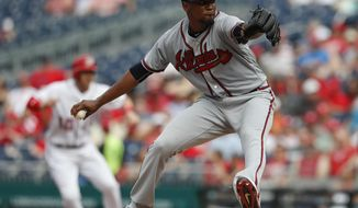 Atlanta Braves starting pitcher Julio Teheran (49) throws during the second inning of a baseball game against the Washington Nationals at Nationals Park, Wednesday, June 14, 2017, in Washington.(AP Photo/Carolyn Kaster)
