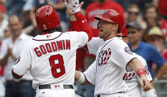 Washington Nationals Brian Goodwin (8) celebrates hitting a two-run home run with teammate Stephen Drew (10) in the second inning of a baseball game against the Atlanta Braves at Nationals Park, Wednesday, June 14, 2017, in Washington.(AP Photo/Carolyn Kaster)