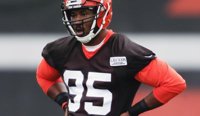 FILE - In this May 12, 2017, file photo, Cleveland Browns' Myles Garrett listens to his coaches during NFL football rookie minicamp, in Berea, Ohio. Myles Garrett limped off the field Wednesday, June 14, 2017 a scary sight for the Cleveland Browns. The No. 1 overall draft pick sustained an injury to his left foot late in practice while rushing quarterback Brock Osweiler during a two-minute drill. (AP Photo/Ron Schwane, File)