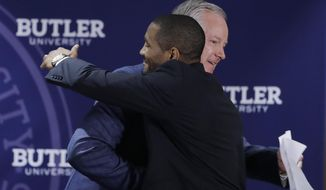 Butler athletic director Barry Collier, left, congratulates LaVall Jordan during an NCAA college basketball news conference introducing Jordan as the new men's head basketball coach at Butler, Wednesday, June 14, 2017, in Indianapolis. (AP Photo/Darron Cummings)