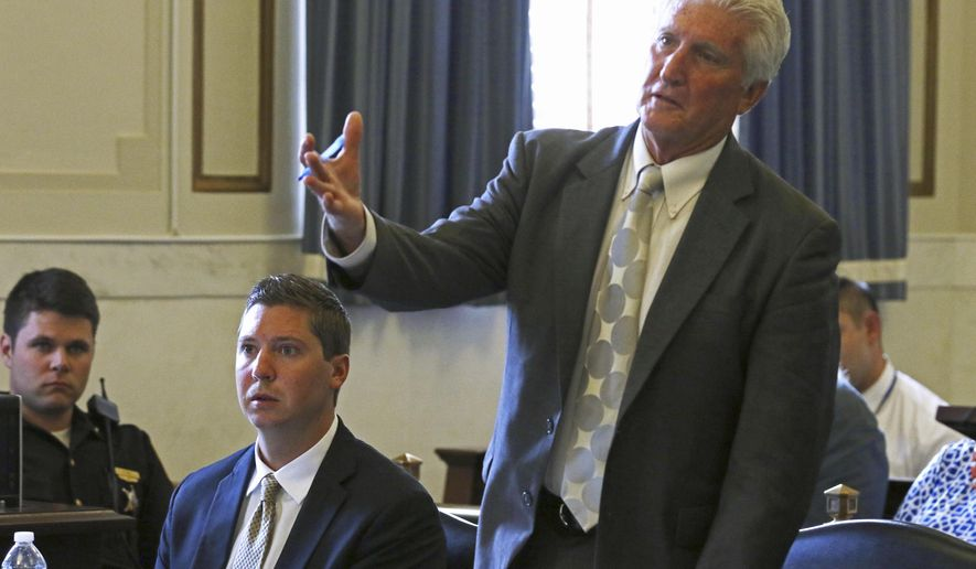 Former University of Cincinnati officer Ray Tensing , second from left, watches as his attorney Stewart Mathews, right, speaks during testimony in Tensing's retrial Tuesday, June 13, 2017, in the Hamilton County Courthouse in Cincinnati. Tensing is charged with murder and voluntary manslaughter in the shooting of unarmed black motorist Sam DuBose during a July 19, 2015, traffic stop.  (Cara Owsley/The Cincinnati Enquirer via AP, Pool)