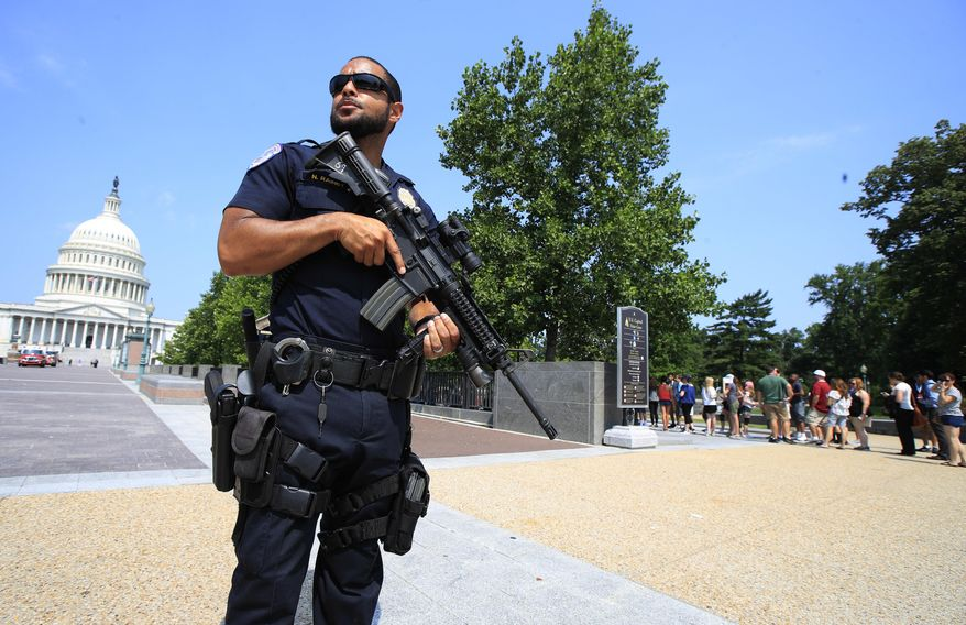Capitol Hill Police officer Nathan Rainey stands guard on Capitol Hill in Washington, Wednesday, June 14, 2017, after House Majority Whip Steve Scalise of La. was shot during a congressional baseball practice in Alexandria, Va. (AP Photo/Manuel Balce Ceneta)