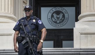 A Capitol Hill Police officer stands his post at the entrance to the House of Representatives on Capitol Hill in Washington, Wednesday, June 14, 2017, after House Majority Whip Steve Scalise of La., and others, were injured in a shooting during a congressional baseball practice in Alexandria, Va. (AP Photo/J. Scott Applewhite)