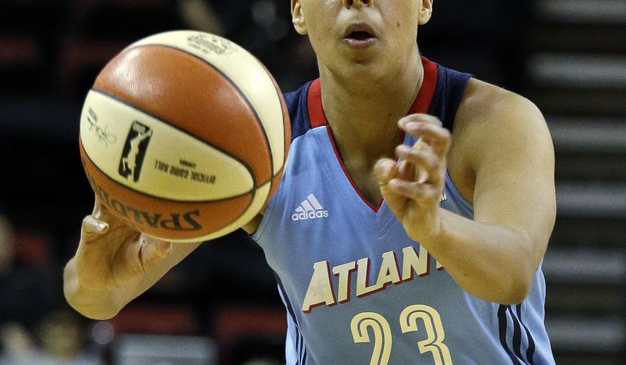 Atlanta Dream's Layshia Clarendon passes the ball against the Seattle Storm during the first half of a WNBA basketball game Tuesday, June 13, 2017, in Seattle. (AP Photo/Elaine Thompson)