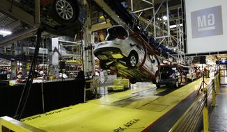 FILE - In this Monday, Jan. 28, 2013, file photo, cars move along an assembly line at the General Motors Fairfax plant in Kansas City, Kan. General Motors is extending the normal two-week summer shutdown at two U.S. car factories because of slumping demand. Union officials say the Lordstown, Ohio, plant near Cleveland and the Fairfax plant in Kansas City, Kan., will close for as long as five weeks in June and July 2017. (AP Photo/Orlin Wagner, File)