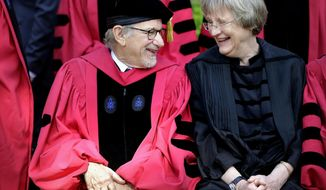 """FILE - In this May 26, 2016 file photo filmmaker Steven Spielberg, left, speaks with Harvard President Drew Faust, right, while sitting for a photograph before Harvard University commencement exercises, in Cambridge, Mass. President Faust, who was the first woman to lead Harvard University, announced Wednesday, June 14, 2017,  that she will leave her post after the upcoming academic year saying in a letter """"it will be the right time for the transition to Harvard's next chapter, led by a new president."""" (AP Photo/Steven Senne, File)"""