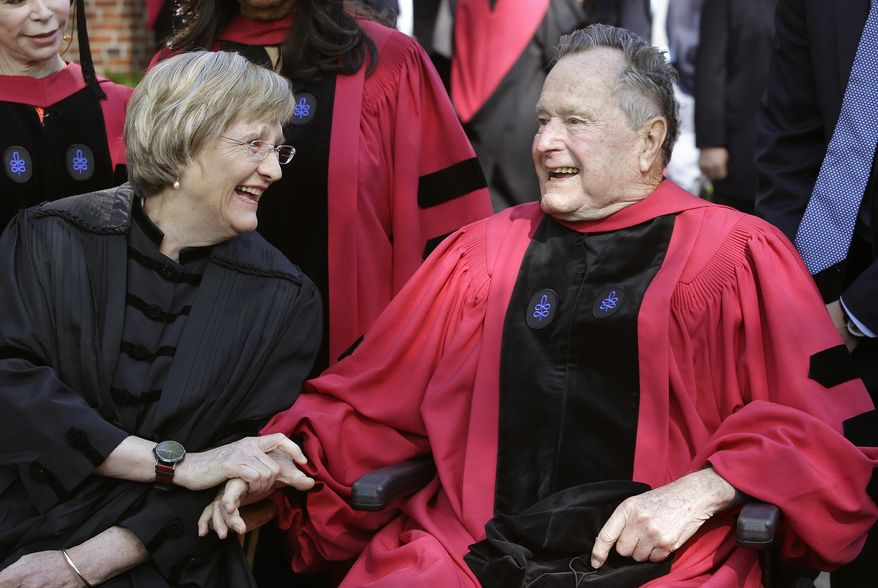 """FILE - In this May 29, 2014 file photo Harvard University President Drew Faust, left, speaks with former President George H. W. Bush, right, before Harvard commencement ceremonies in Cambridge, Mass. Bush was presented with an honorary doctor of laws degree during the ceremonies. President Faust, who was the first woman to lead Harvard University, announced Wednesday, June 14, 2017,  that she will leave her post after the upcoming academic year saying in a letter """"it will be the right time for the transition to Harvard's next chapter, led by a new president."""" (AP Photo/Steven Senne, File)"""
