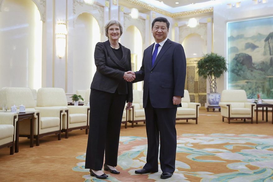 """FILE - In this March 16, 2015 file photo Chinese President Xi Jinping, right, poses with Harvard University President Drew Faust for photos at the Great Hall of the People in Beijing, China. President Faust, who was the first woman to lead Harvard University, announced Wednesday, June 14, 2017, that she will leave her post after the upcoming academic year saying in a letter """"it will be the right time for the transition to Harvard's next chapter, led by a new president."""" (AP Photo/Feng Li, Pool, File)"""