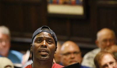 """In this Tuesday, June 13, 2017, photo, Dallas Street Choir member Michael Brown raises his voice during a rehearsal for their performance at Carnegie Hall on Wednesday evening, at the Fifth Avenue Presbyterian Church in New York. """"We may be homeless, but we're not voiceless,"""" he said at the rehearsal Tuesday, """"so let's use our effort to remind people that we still have hope and it will never die."""" (AP Photo/Kathy Willens)"""
