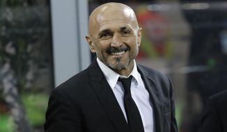 FILE - In this Feb. 26, 2017 file photo then Roma coach Luciano Spalletti smiles prior to an Italian Serie A soccer match between Inter Milan and Roma, at the San Siro stadium in Milan, Italy. In his first press conference since being confirmed as Inter Milan coach Luciano Spalletti on Wednesday, June 14, 2017 said the Nerazzurri should fear no one if they are to cut the gap between them and six-time reigning Italian champion Juventus. (AP Photo/Luca Bruno, file)